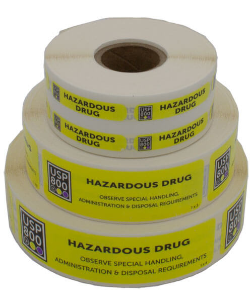 Three stacked rolls of bright yellow Hazardous Drug Label stickers | Maxpert Medical